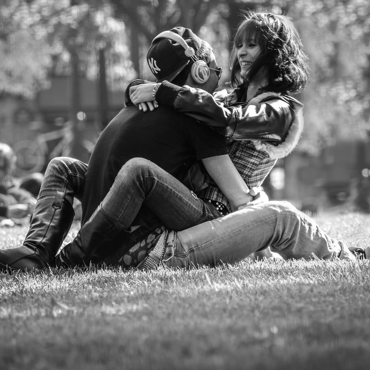 Three Loves Theory: Couple hugging in a park