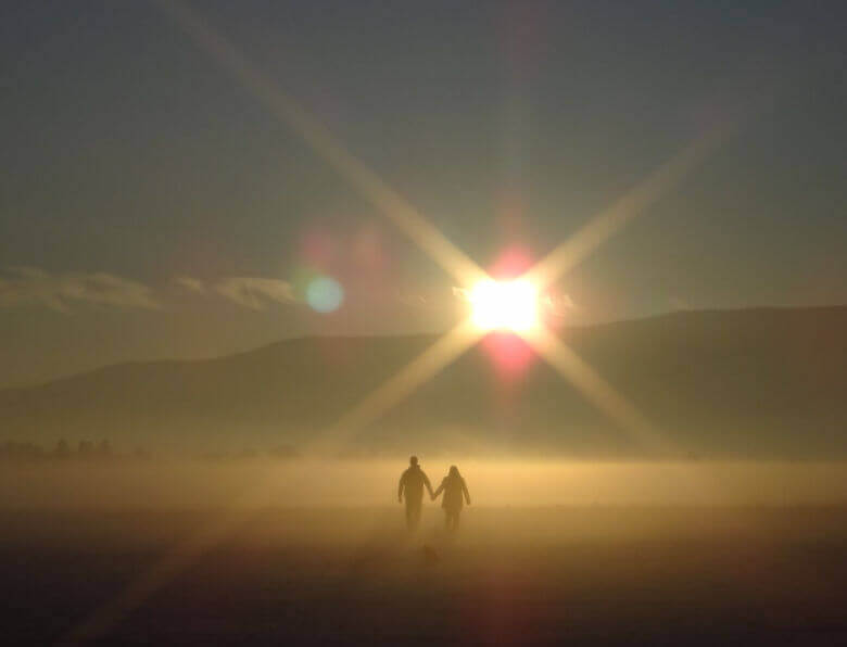Three loves: couple walking into the sunset