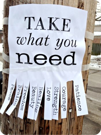 A message on a pole saying 'Take what you need'. You can tear off pieces of paper with words like Patience and Courage