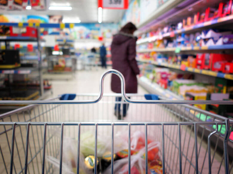 Woman shopping at the supermarket with trolley
