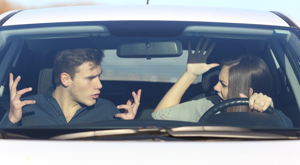 Couple arguing while she is driving a car in a dangerous situation