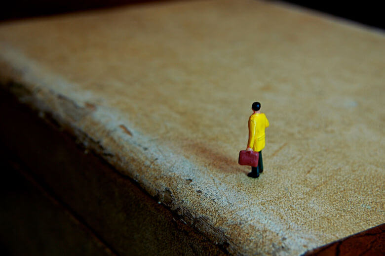 Small toy figure of man with suitcase