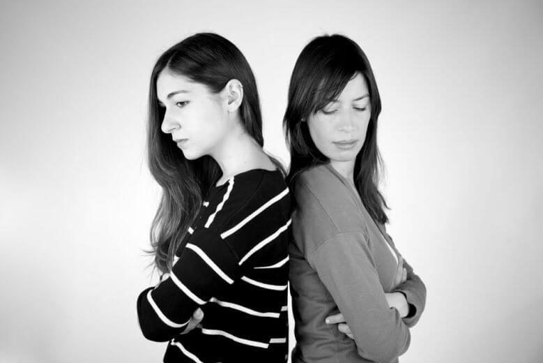 Two girlfriends angry not talking to each other not looking B&W