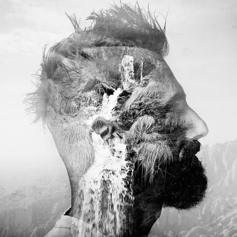 Self-awareness BW double exposure portrait of a man with mohawk and a mountain