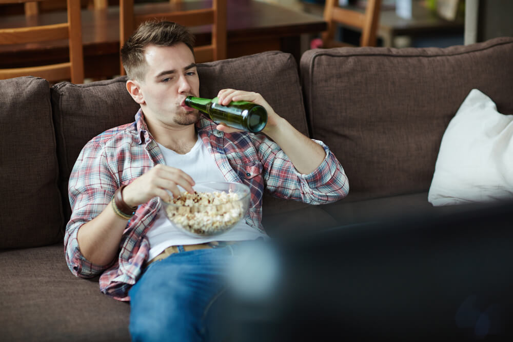 Man on the couch drinking beer - stop trying to change yourself
