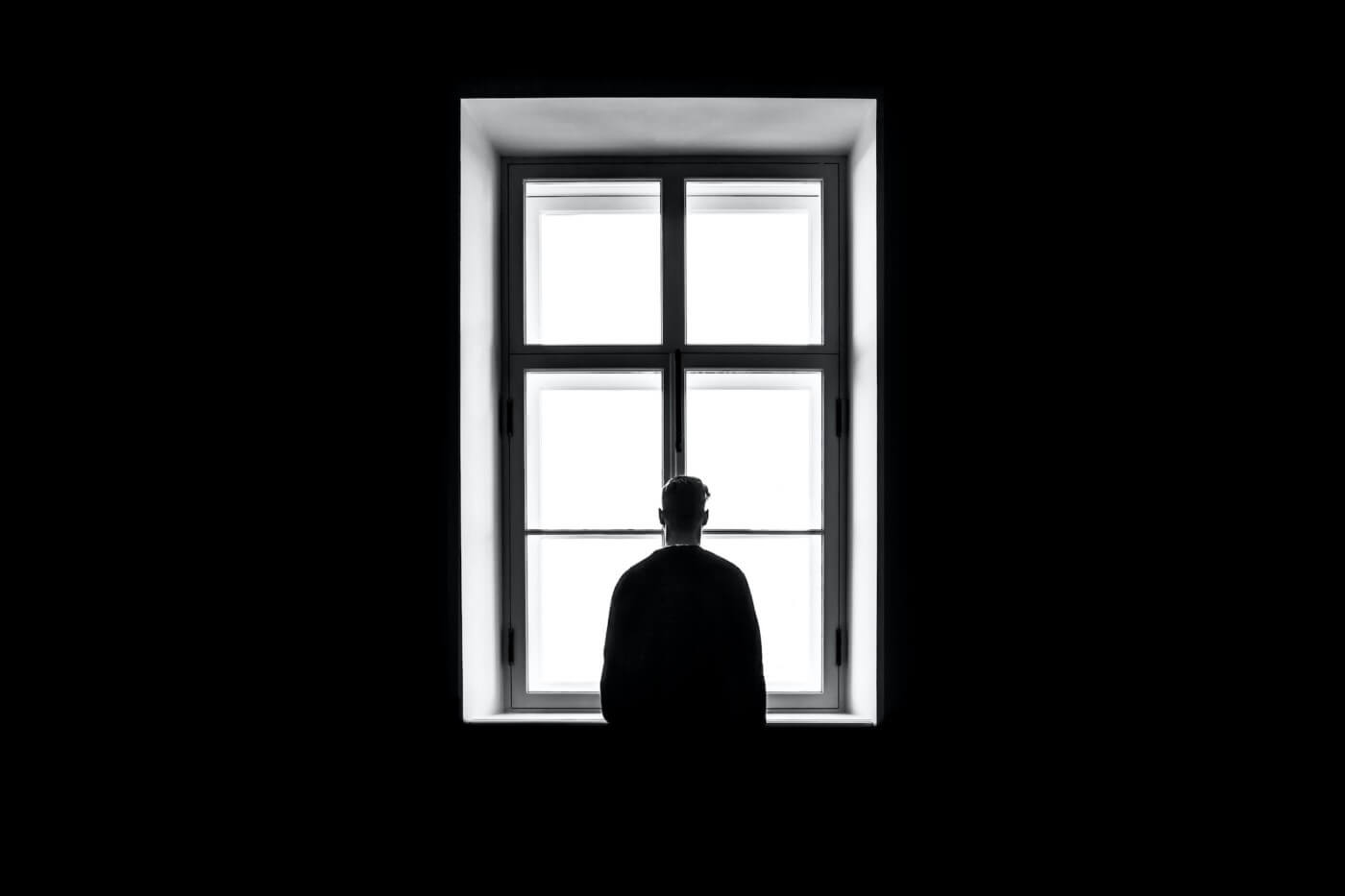lonely man by the window